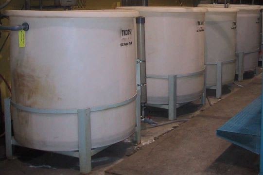 SX feed, scrub solution, and strip solution feed tanks for a solvent extraction pilot plant.