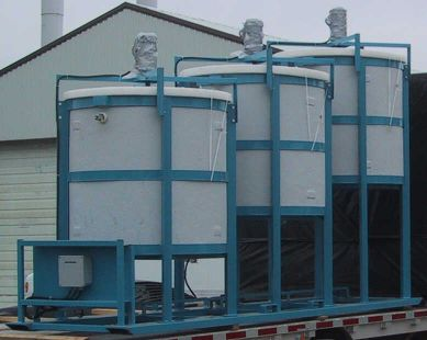 Agitation pilot plant tanks wraped in fibreglass (FRP) for pilot plant leach circuit.