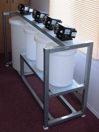 SX feed, scrub solution, strip solution, and organic feed tanks with metering pumps