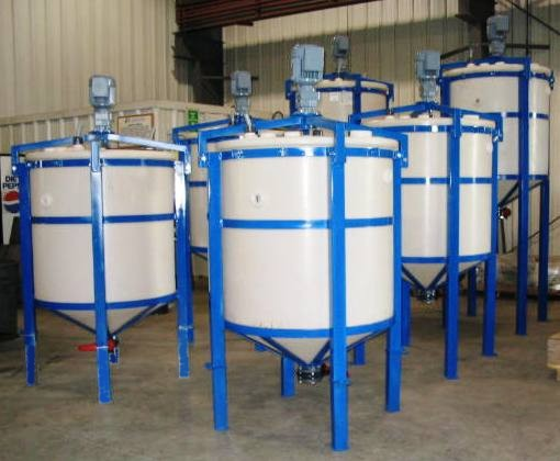 Leach tanks arranged for cascading flow.
